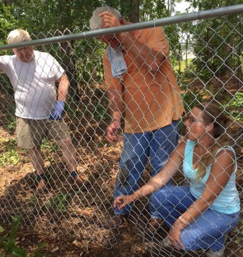 Club folks putting fence up