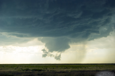 A wall cloud and scud clouds develop with a parent supercell over southeastern Colorado.