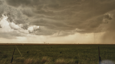 A weak tornado takes shape over west central Oklahoma. Note the dust whirl displaced to the left of the funnel.