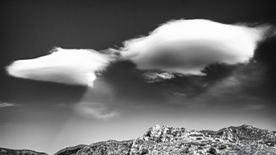 "Altocumulus Standing Lenticularis or ""lennies"" seen over the Sandia mountains."