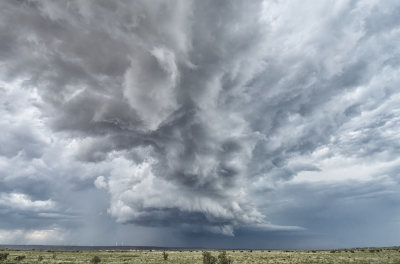 A supercell exhibits well-defined structure with a wall cloud in east central New Mexico near Pastura.