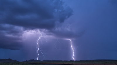 A pair of cloud-to-ground lightning strikes seen in central New Mexico.