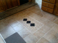 Tile 'rug' design matching stove backsplash