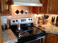 New backsplash with rug design and granite countertops