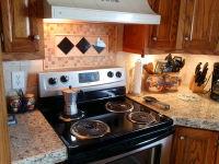 New backsplash with rug design and granite countertops