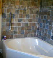 New tile and corner Roman tub installed