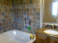 Tilework and new vanity in master bath