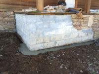 Repairs to stone veneer on porch
