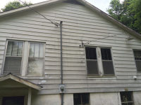 Old siding before being replaced