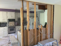 Wall torn out between kitchen and living area