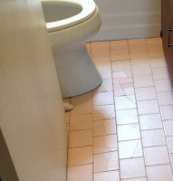 Water damage on bathroom floor