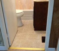 Bathroom floor repaired and new vinyl put down