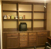 Shelving and cabinets added for additional storage
