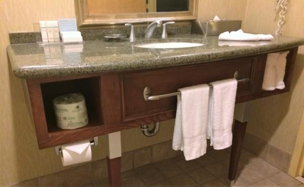 Bathroom Vanity, sink, faucet.