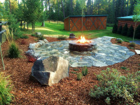 Fire pit surrounded by flagstone pavers