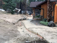 excavating hillside in front of home
