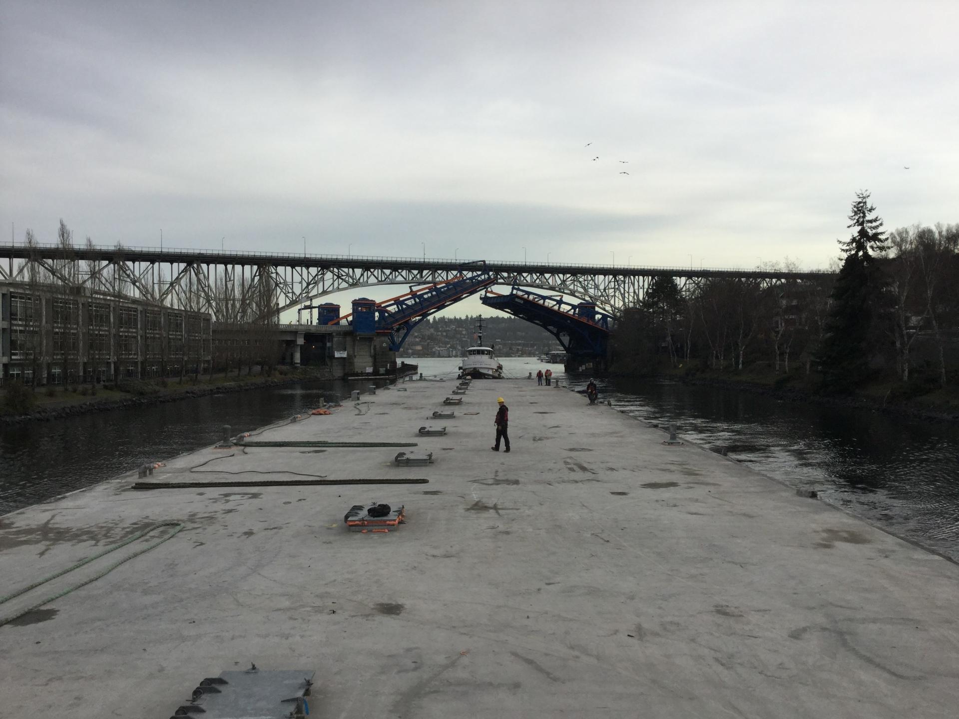 Pontoon leaves Lake Washington, part of the disassembly of the old 520 bridge.