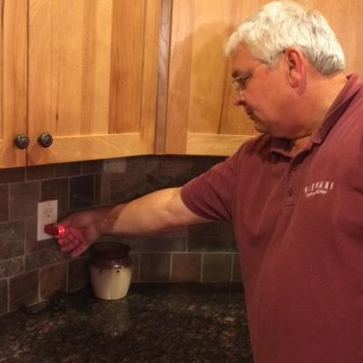 Chuck tests GFI outlets in a home in Ankeny.