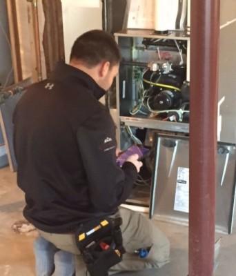 Chris checks a buyer's furnace.