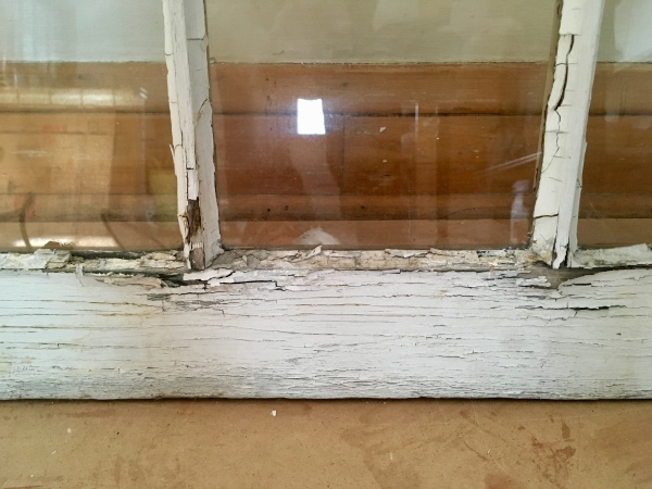Failing glaze and exterior paint of lower sash.