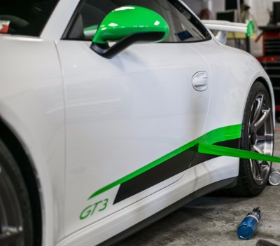image of strips being put on a car using knifeless tape.