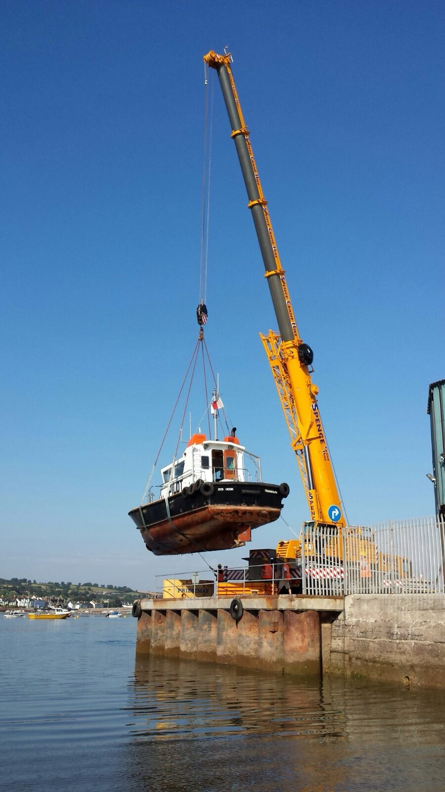 Pilot vessel Syd Hook being craned after annual refit
