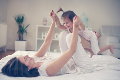 A woman able to play with her kid because NeckTek helped her to relief her neck pain