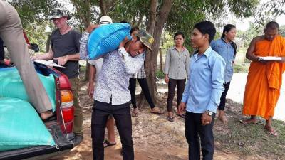 Distributing Rice to families in Lolei Village