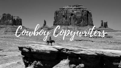 Cowboy riding through the desert on a horse