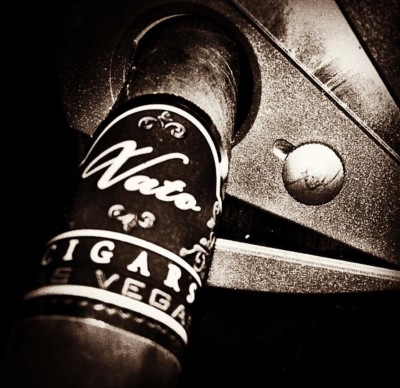 Vato Cigar Being Cut with a Xikar Cutter.
