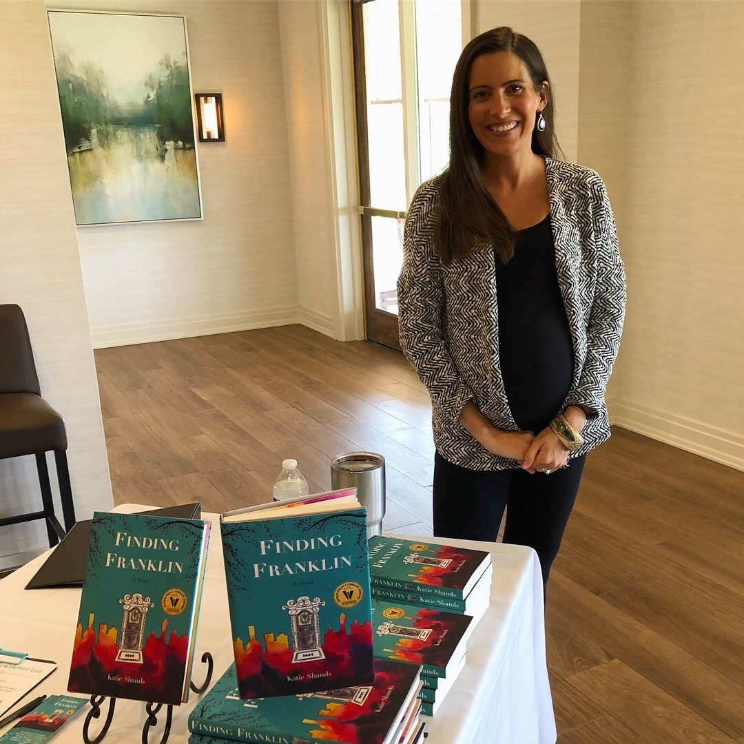"""Katie Shands poses with her book """"Finding Franklin"""" at the October meeting of the Williamson County Newcomer's Club"""