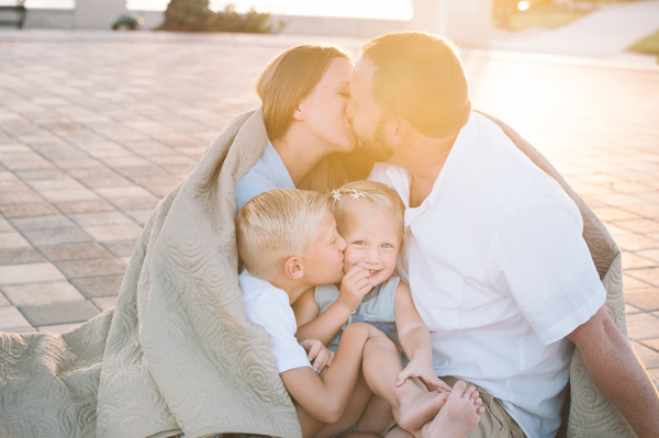 fresno family snuggling at golden hour by Cayton Heath Photography