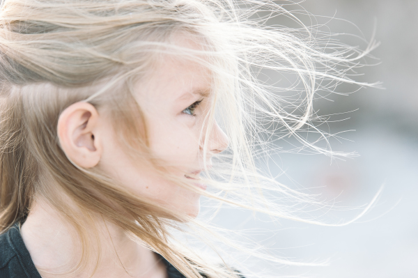 little girl with wind in her hair from Fresno California by Cayton Heath Photography