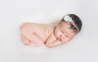 Newborn baby girl with flower headband in fresno county, Cayton Heath Photography