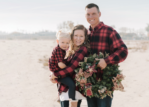 fresno county family christmas picture in a feild with a wreath