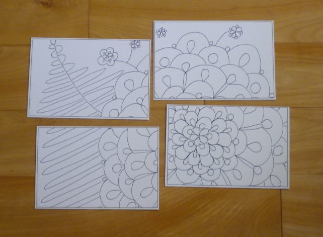4in1-31 mosaic, 4-Tiles of postcards to form a large, flower, puzzle.  All in black and white.