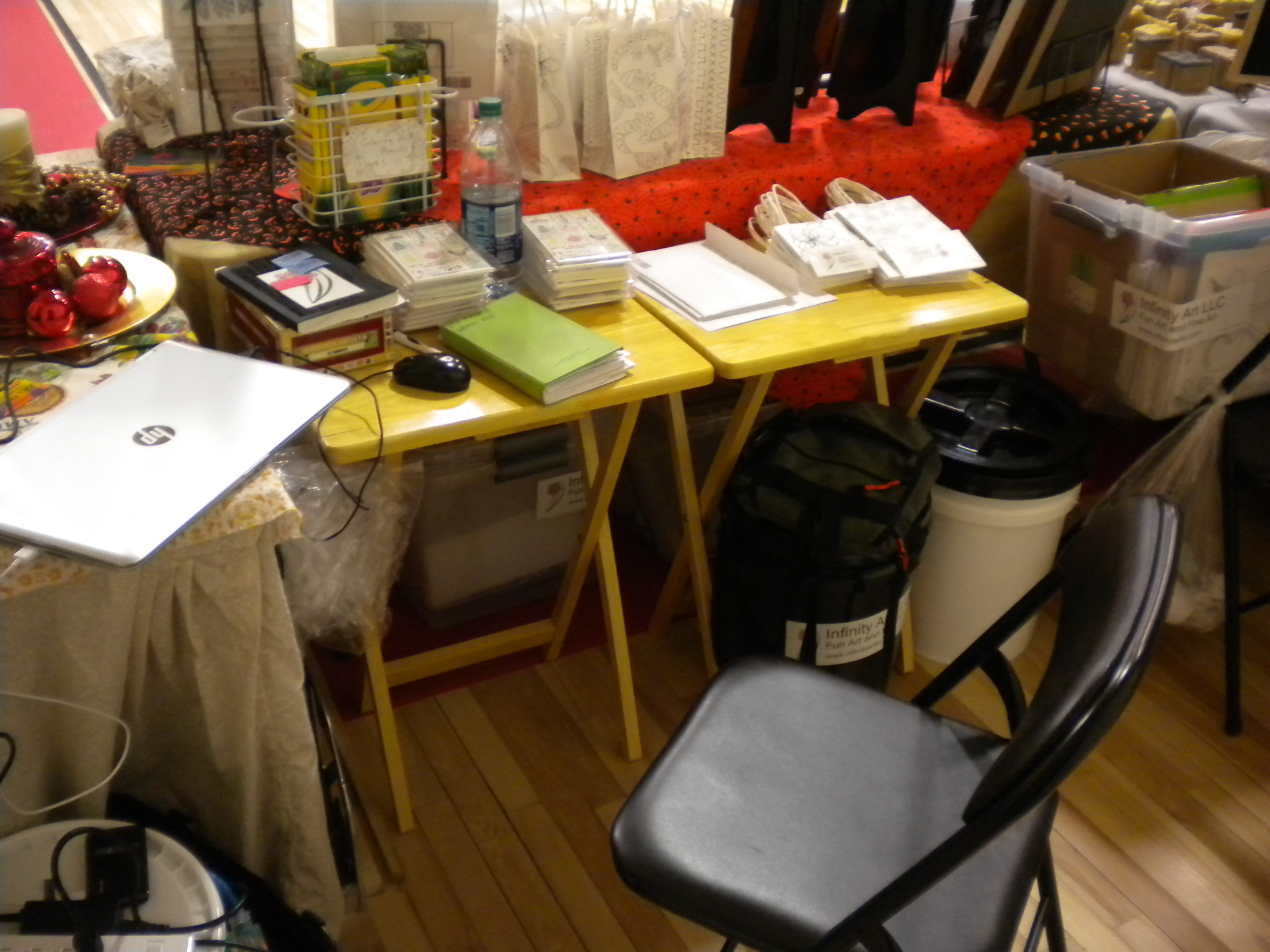 Photo of the back of my booth at the Fall Foliage Show in Hardwick, VT.  Totes, paperwork, sales boo