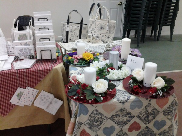 Photo of booth with valentine's day centerpieces at the Bolton Valley Winter Market.