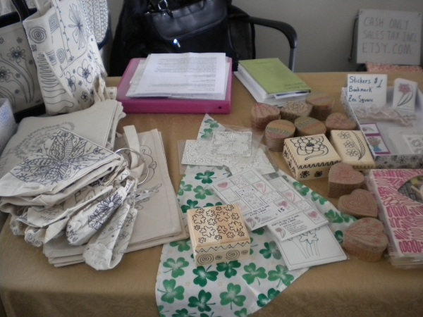 Photo of booth set up at BVWM with shamrocks.