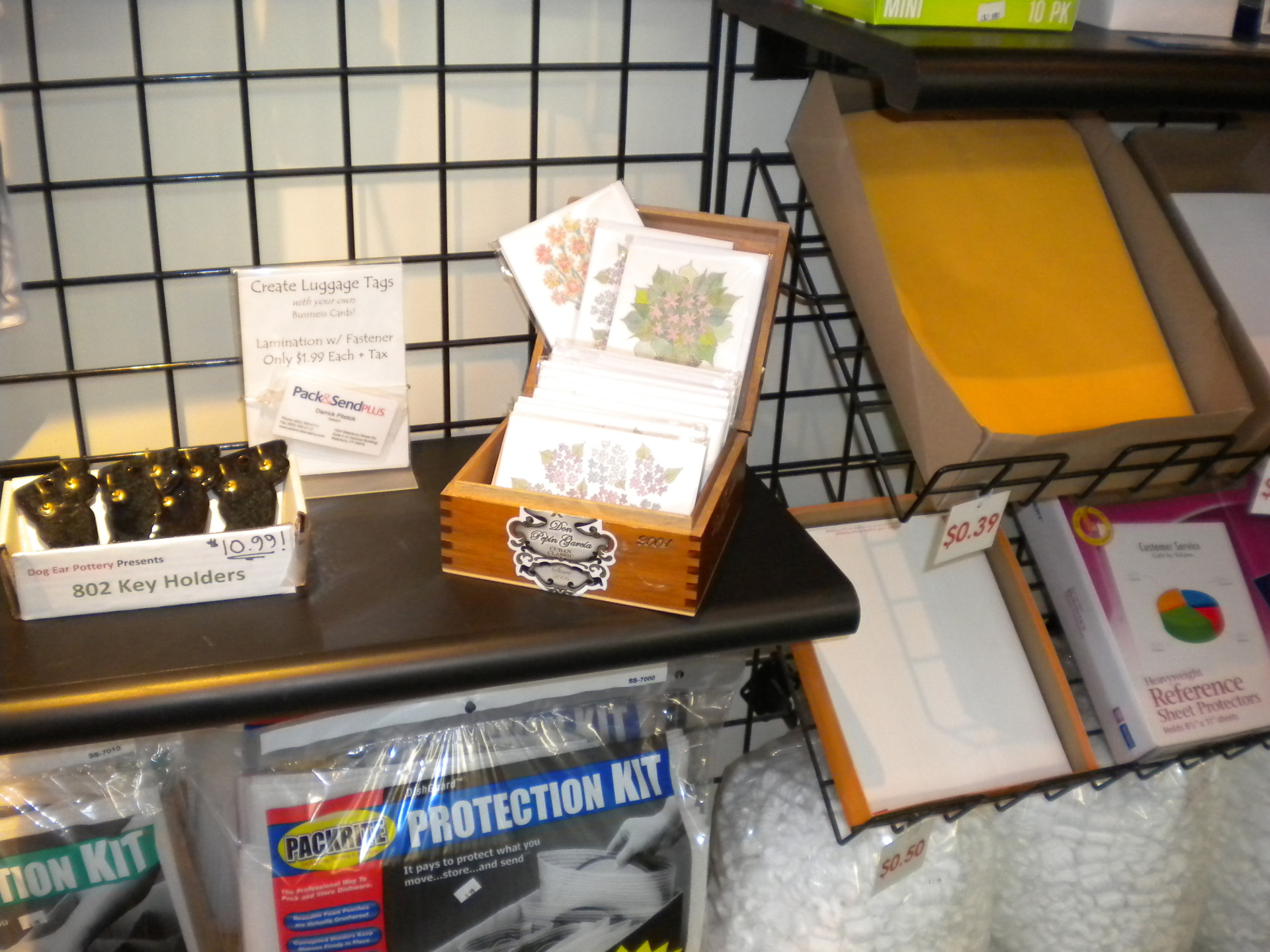 Photo of the display of Infinity Art Cards and the Pack & Send Plus in Waterbury VT.