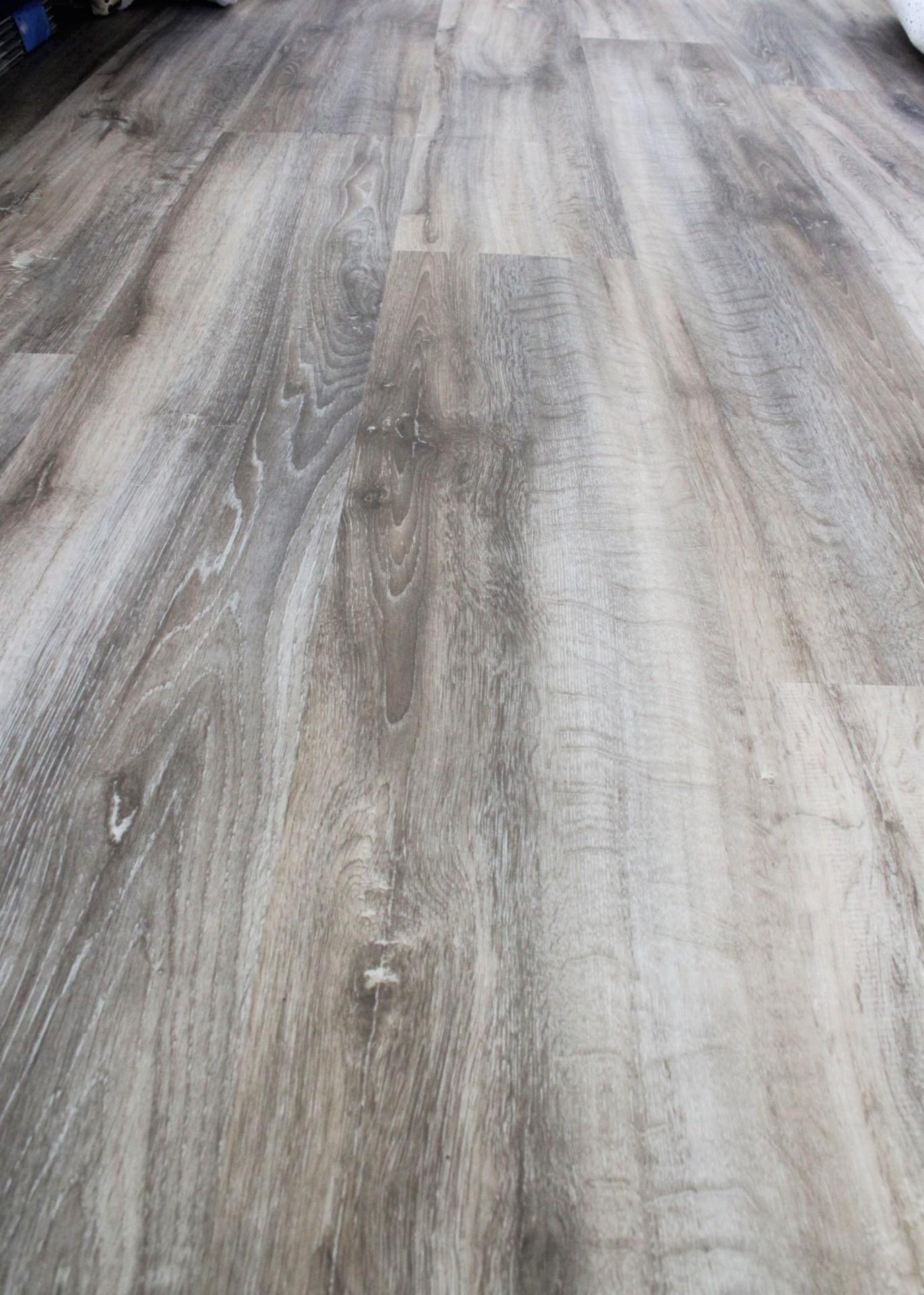 Vinyl, vinyl flooring, luxury vinyl planks, waterproof flooring, water resistant flooring, waterproof wood floors, pcp flooring, planking, grey floor, light floor, knots, laminate