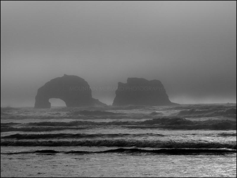 Arched sea stacks in fog, Rockaway Beach, Oregon