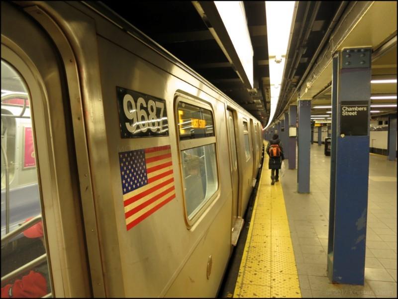E train at Chambers St.