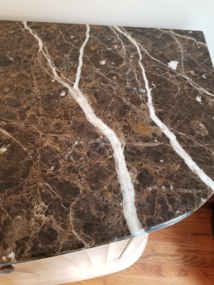 Marble repair on Emperador Dark table top