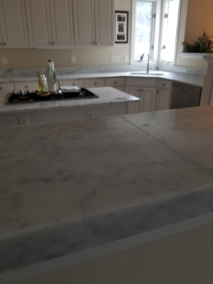 White Carrara marble etching repair