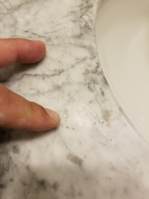 Scratch repair on marble