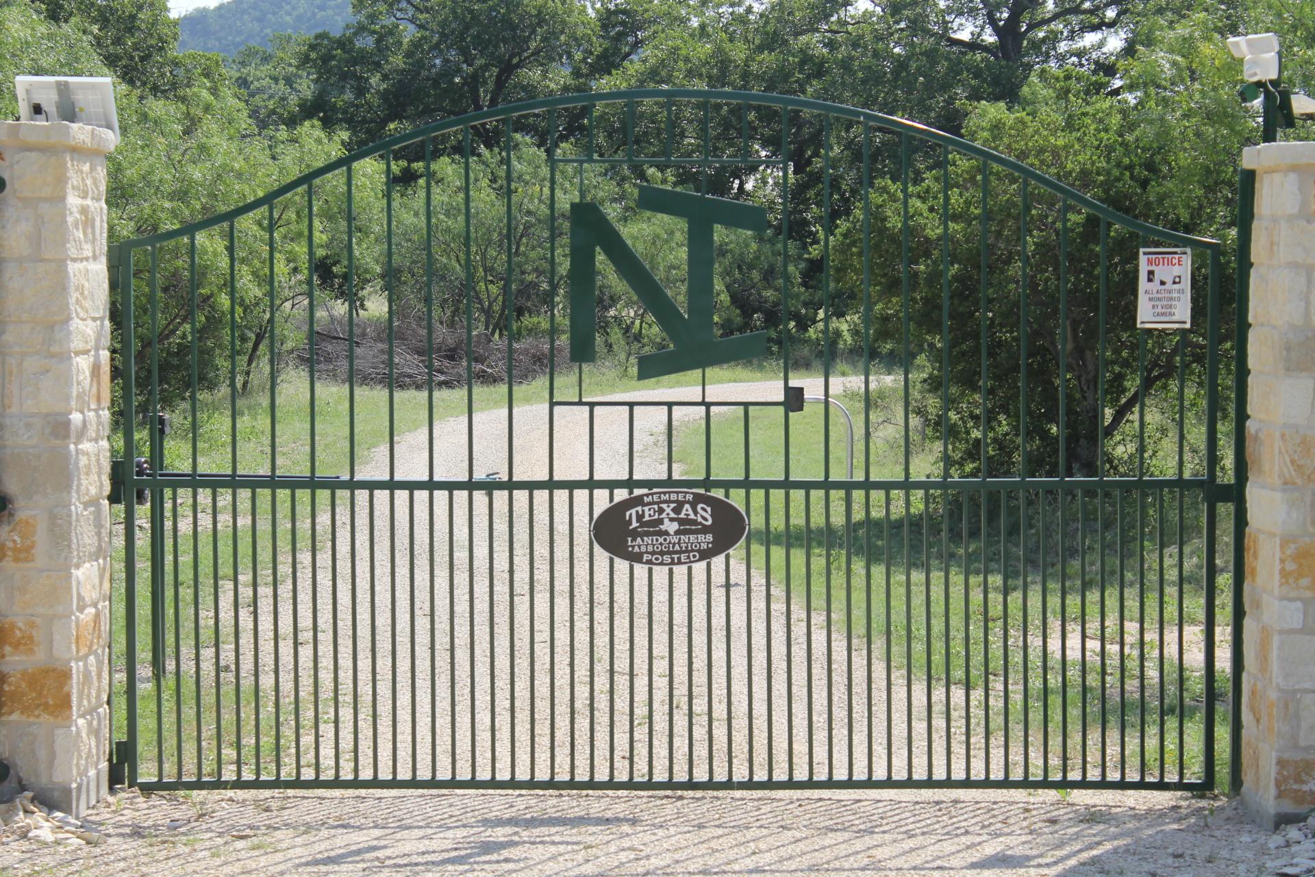 Custom gate with Alamo arch