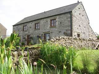 Detached stone barn conversion sleeping seven in Buxton, Peak District.