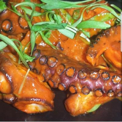Octopus a la plancha, spicy Harissa sauce, micro pea leaves