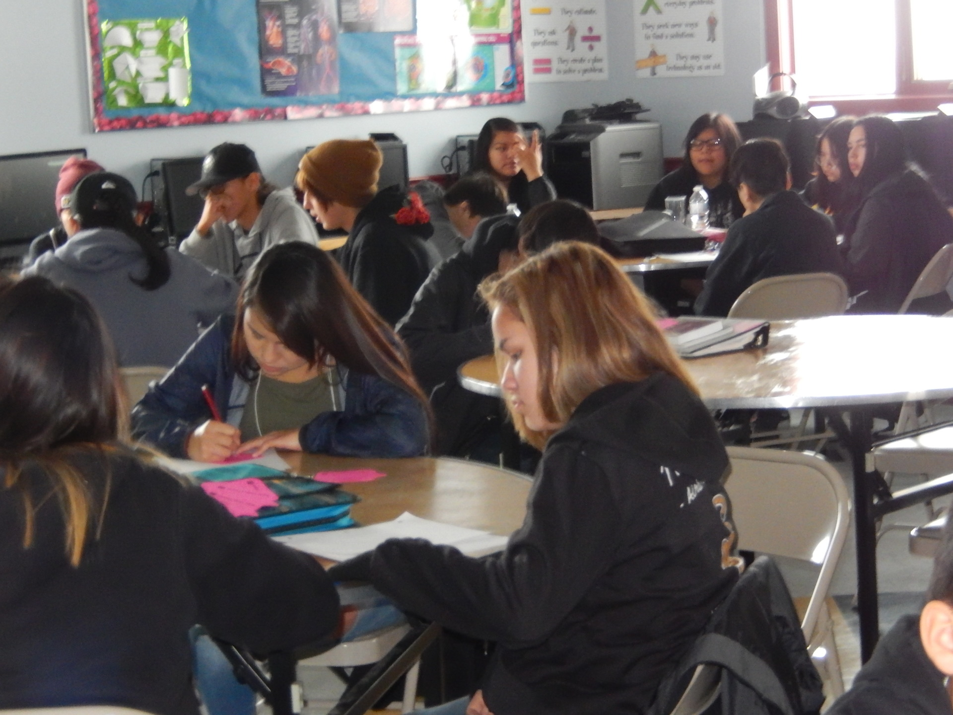 SOS Students engaged in a writing workshop